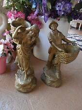 """VINTAGE 1973 PLASTER STATUES antiqued gold man & women baskets aprx 17"""" tall"""