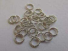 Twisted Sterling Silver Open Jump Rings (1.0mm wire, approx. AWG 18). Pack of 10