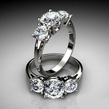 Three Stone Past Present Future Engagement Ring in Gold and Platinum