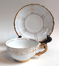 Seyei Fine China Japan # 1030 Teacup and Saucer, White with Gold Trim and Design