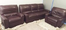 Leather lounge suite - three seater plus two single recliners