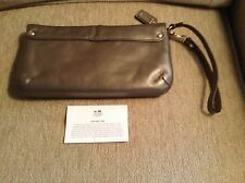 BRAND NEW COACH BRONZE LEATHER WRISTLET with strap