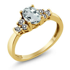 0.63 Ct Oval Sky Blue Aquamarine White Diamond 18K Yellow Gold Ring