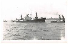 Troilus - cargo ship being pulled by tug - c1950's plain-backed postcard