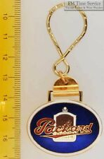 Sturdy key chain with an oval gold-toned Packard shield