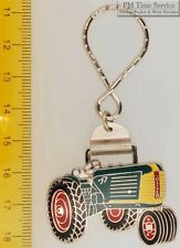 Sturdy key chain with a fancy silver-toned Oliver tractor shield