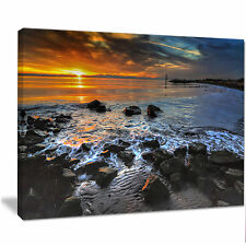 Design Art 'Sunset Over Rocky Ocean Shore' Photographic Print on Wrapped Canvas