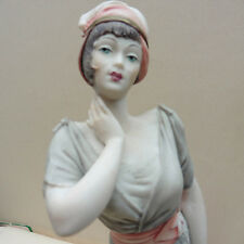 Signed Art Deco Capodimonte lady figure with fan and rose. 10 ins/23cms