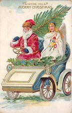 Merry Christmas c1910 Postcard Santa Claus Driving Car with Angel & Tree