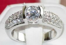 R328  WOMENS SIMULATED DIAMOND RING WITH A SOLITAIRE AND PAVE SET SPARKLING GEMS