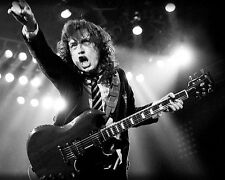 AC/DC Angus Young Iconic Image with Guitar in Concert Poster or Photo