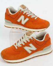 New Balance 574 Trainers in Orange & Moonbeam - iconic runners retro classic