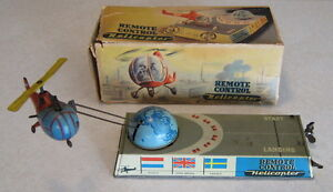 1957 tin wind up remote helicopter