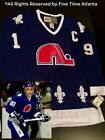 CCM Vintage Joe Sakic Quebec Nordiques Mens Blue Home Retro Fight Strap Jersey