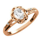 0.57 Ct Oval White Topaz White Sapphire Rose Gold Plated Sterling Silver Ring