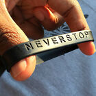 NEVER STOP - Band Silicone Rubber Bracelet Wristband.Adult Size Brand New