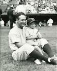 Baseball New York Yankees Lou Gehrig playing with a small child Photo Picture