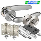 Door Handle Pack for Bathroom Doors with Brushed Stainless Steel Levers on Rose
