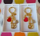 MICHAEL KORS HEART CHARMS GOLD TONE IN BRIGHT RED & ULTRA PINK.