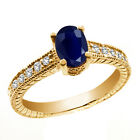 1.42 Ct Oval Blue Sapphire White Topaz 14K Yellow Gold Ring