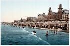 5423.People enjoying beach in front of promenade.POSTER.Decoration.Graphic Art