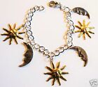 HAPPY SUN  RAY AND MOON FACE GOLD AND SILVER TONE CHARM BRACELET