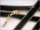 Black unique decorative metal zip with light brass colour teeth. No3. Closed End