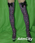 Admcity Opaque leopard print thigh highs with satin bow.