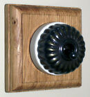 Period Single Oak Pattress with Ribbed Antique Brass Ivory Ceramic Dolly Switch