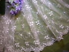 "White embroidered mesh netting- 1 yd 15"" long X 52"" wide."