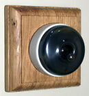 Period Single Oak Pattress with Plain Antique Brass Ivory Ceramic Dolly Switch