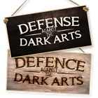 "WITCHCRAFT AND WIZARDRY HANGING SIGN ""DEFENCE AGAINST THE DARK ARTS"" dark/light"