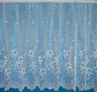 Lagos A Floral Lilly With Scalloped Block  Base White Net Curtain By The Metre