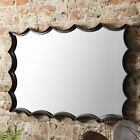MRROR Striking, scalloped feature mirror in a metal frame with an iron-look  108