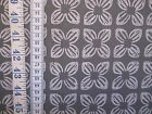 Block Flower fabric in grey 100% cotton from 'Animal Bazaar' by Michael Miller