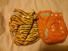 Various washable birth to potty nappies in excellent condition