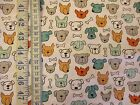 Dog faces fabric for all dog lovers on white 100% cotton from Clothworks