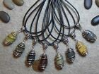 5 Cage Wrapped Pendants- Natural, water smoothed beach stones