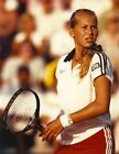 Anna Kournikova in White Shirt and Red Skirt High Quality Photo