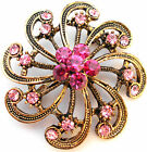 Ladies Brooch. Gilt crystal and round scroll brooch. In Various colours - (02)