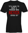 Its Hard To Beat A person Who Never Give Up T-shirts