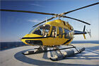 Poster / Leinwandbild A Bell 407 utility helicopter on the helip... - T. Moore