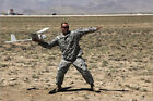 Poster / Leinwandbild U.S. Army soldier launches an RQ-1... - StockTrek Images