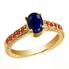 1.42 Ct Oval Blue Sapphire Red Garnet 14K Yellow Gold Ring