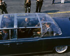 President John F. Kennedy in back of Presidential limousine Photo Print