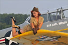 Poster / Leinwandbild 1940's style pin-up girl lying on a T-6 ... - C. Kieffer