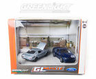 GREENLIGHT 1:64 DIECAST MUSTANG DIORAMA WITH A BARE METAL 1965 AND BLUE 2010 GT