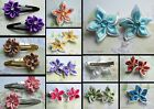 STAR FLOWER OR ROSETTE HAIR CLIP GRIP FLOWER RIBBON CRYSTAL SINGLE OR PAIR