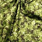 Gorgeous Metallic Gold &  Green Packed Leaves Cotton Fabric by Hoffman