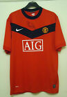 MANCHESTER UNITED  FOOTBALL SHIRT BY NIKE  SIZE L SIGNED BY BRYAN ROBSON